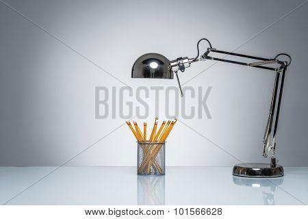 Lighting Up Orange Pencil Holder Stationery With Desk Lamp