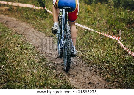 girl mountain bike rides on trail
