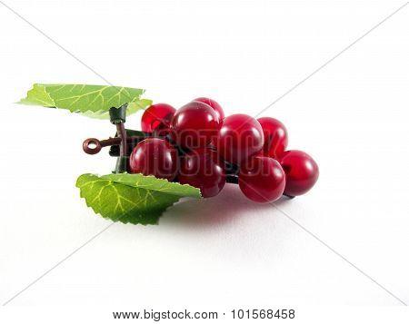 Created plastic grape fruit shape on black hairpin