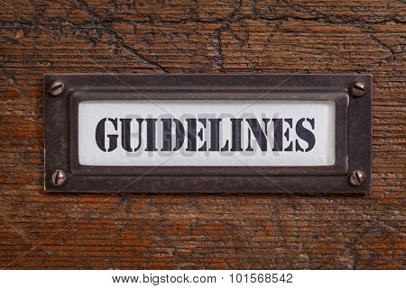 guidelines - file cabinet label, bronze holder against grunge and scratched wood