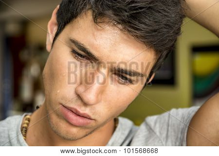 Close Up Face Of A Pensive Young Man Crying