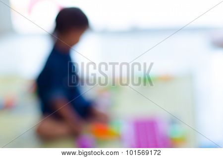 The Blur Of Child's Playing Indoor.