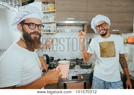 food and people concept - happy male chef cook baking over kitchen background