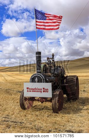 Old Steam Engine With Us Flag.