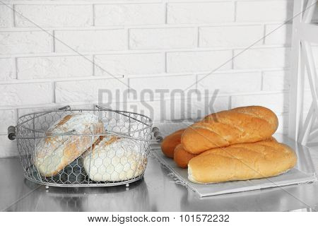 Fresh bread on table, in kitchen of bakery