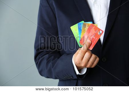 Businessman holding credit card,  close-up