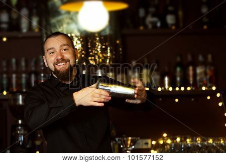 Bartender with shaker making cocktail