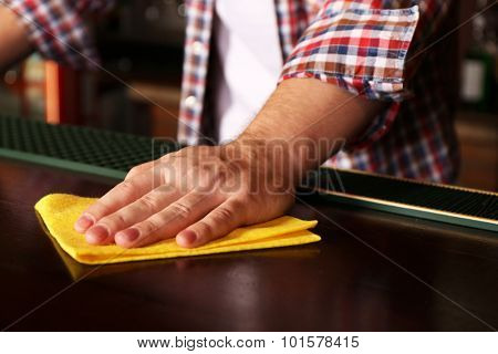 Bartender wiping down bar counter