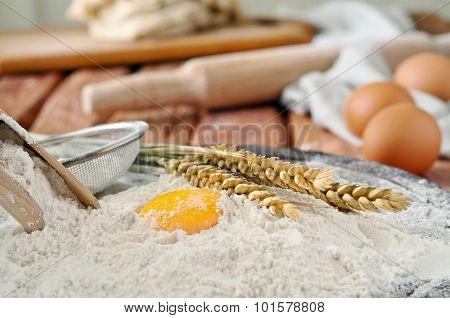 Egg Yolk In Flour Closeup On A Wooden Board In A Bakery