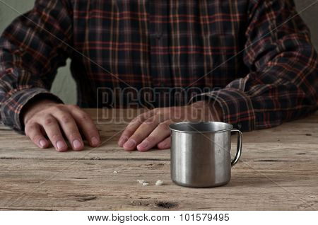 Empty Steel Cup Bread Crumbs On A Wooden Table Closeup