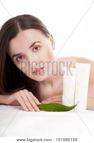 Woman With Well-groomed Skin Near Organic Cosmetics