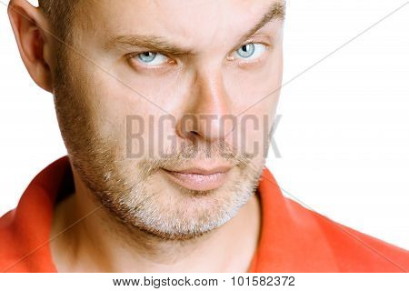 Strict Unshaven Man On A White Background. Close Up