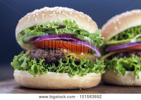 Beef Burgers On A Wooden Board With Aromatic Spices