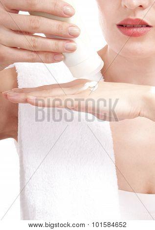Beautiful Woman Applying Cream On Her Hands