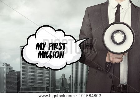 My first million text on speech bubble with businessman and megaphone