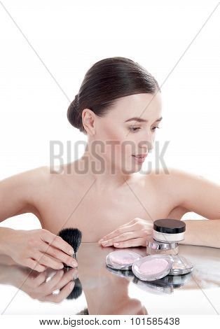 Beautiful Girl With  Cosmetics For Makeup