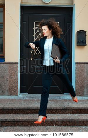 Girl In A Suit Running Hurry.