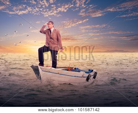 businessman standing on a boat looking to the horizon. Business concept.