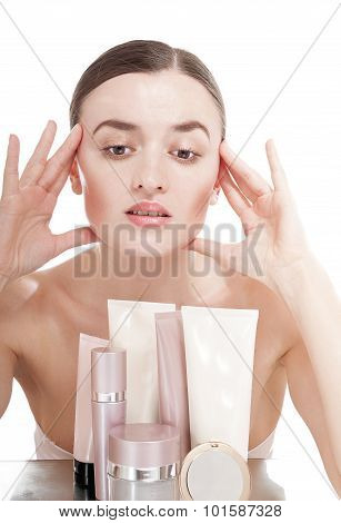 Young Woman With  A Well-groomed Skin Near The Creams Cosmetics