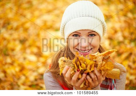 Face Of Happy Girl With Autumn Leaves On Walk