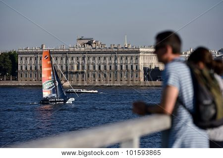 ST. PETERSBURG, RUSSIA - AUGUST 22, 2015: Promotional catamaran of Land Rover on river Neva during St. Petersburg stage of Extreme Sailing Series. Land Rover is the Series main partner