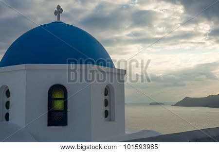 Blue Dome Of White Church And  Clouds, Oia, Santorini, Greece