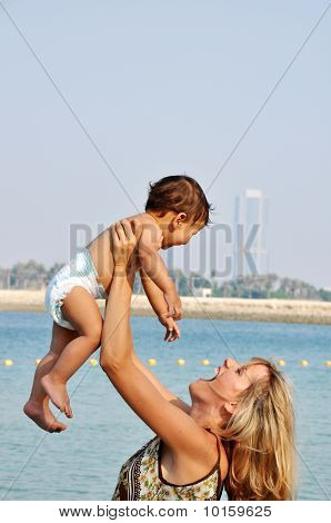 Happy Mother And Son On The Beach