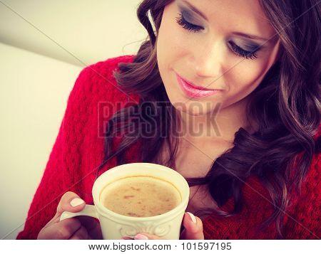 Autumn Woman Holds Mug With Coffee Sitting On Sofa