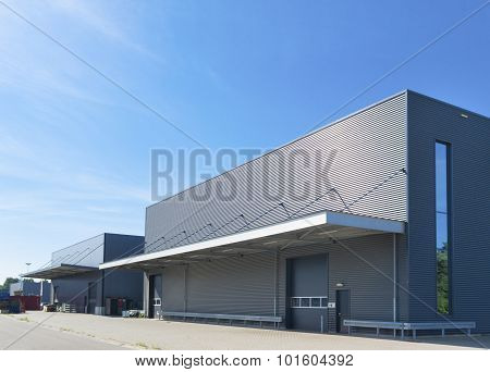 exterior of a modern warehouse building against a blue sky