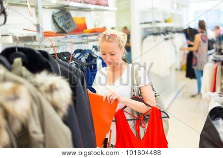 Beautiful woman shopping in clothing store.