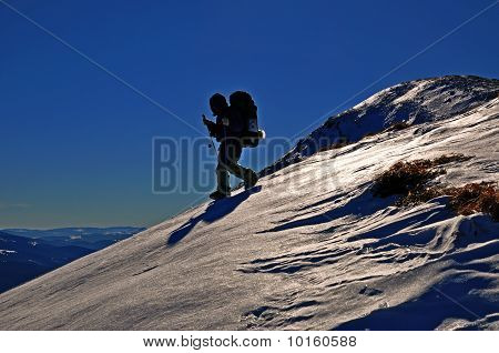The tourist on a snow hillside