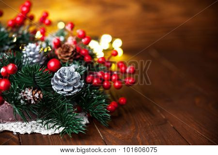 Christmas fir with pinecone and garland