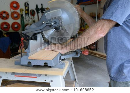 Man Cutting Wood with Table Saw