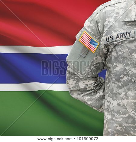American Soldier With Flag On Background - Gambia