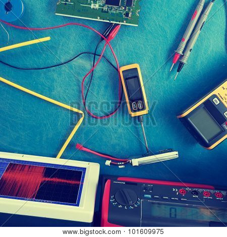 Electronics measuring devices in laboratory. Colored photo