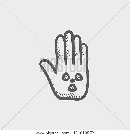 Ionizing radiation sign on a palm sketch icon for web, mobile and infographics. Hand drawn vector dark grey icon isolated on light grey background.