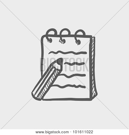 Writing pad and pen sketch icon for web, mobile and infographics. Hand drawn vector dark grey icon isolated on light grey background.