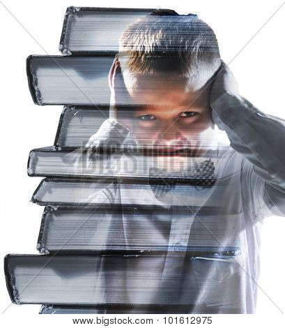 unhappy tired school boy mixed with pile of books, isolated on white background