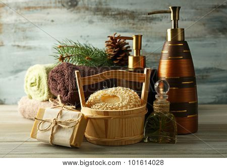 Essential oil of pine, handmade soap and cream with pine extract and spa treatments on wooden background