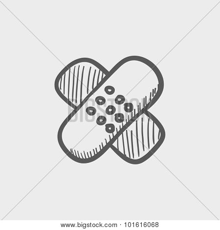 Adhesive bandages sketch icon for web, mobile and infographics. Hand drawn vector dark grey icon isolated on light grey background.