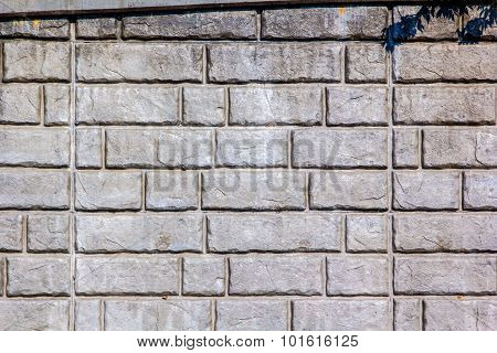 The stone pattern of a brick retaining wall