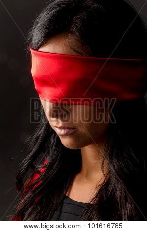 a young woman blindfold.