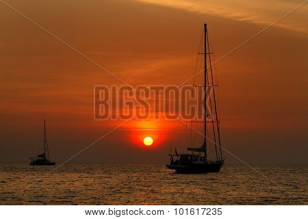 Beautiful Sunset and local fishing boats on sea at Lipe island ,Andaman sea, Satun, Thailand.