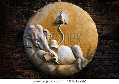 Carved Cement Of Ganesha On Brick Wall