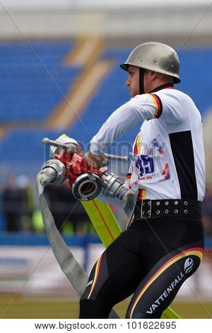 ST. PETERSBURG, RUSSIA - SEPTEMBER 9, 2015: Athlete of team Germany compete in combat deployment during the XI World Championship in Fire and Rescue Sport. First World Championship was held in 2002