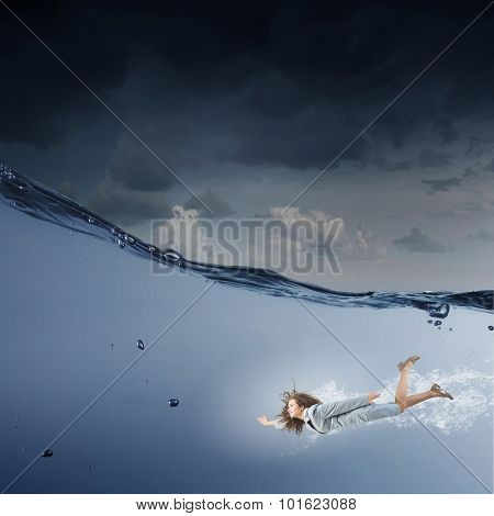 Young businesswoman in suit swimming in stormy waters