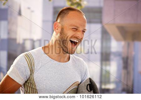 Closeup portrait of shouting young man outdoors.