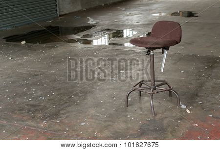 Single Broken Chair In An Abandoned Factory