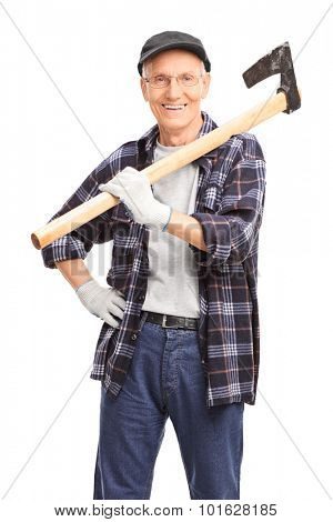 Vertical shot of a senior man holding an axe over his shoulder and looking at the camera isolated on white background