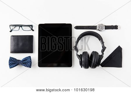hipster personal stuff and objects concept - tablet pc computer, headphones, wallet, eyeglasses and wristwatch on table